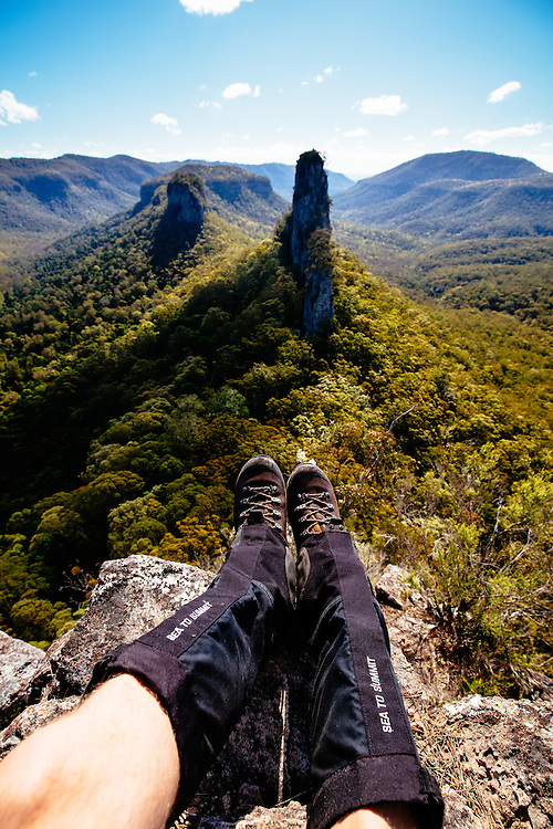 Putting the feet up at a rewarding viewpoint of a mountainous feature in Main Range National Park known as The Steamers. The row of craggy peaks visually resembles the form of a steamboat.