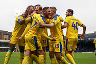 AFC Wimbledon midfielder Scott Wagstaff (7) and AFC Wimbledon attacker Marcus Forss (15) celebrating goal after penatly during the EFL Sky Bet League 1 match between Southend United and AFC Wimbledon at Roots Hall, Southend, England on 12 October 2019.