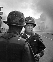 July 9, 1992 - Michigan, U.S. - Lt. General John Throckmorton takes to the field with his paratroopers in riot-torn Detroit on July 25, 1967. Throckmorton is commander of the 4,700 troops sent to Detroit by President Johnson to quell the outbreak. (Credit Image: © Detroit Free Press via ZUMA Wire)