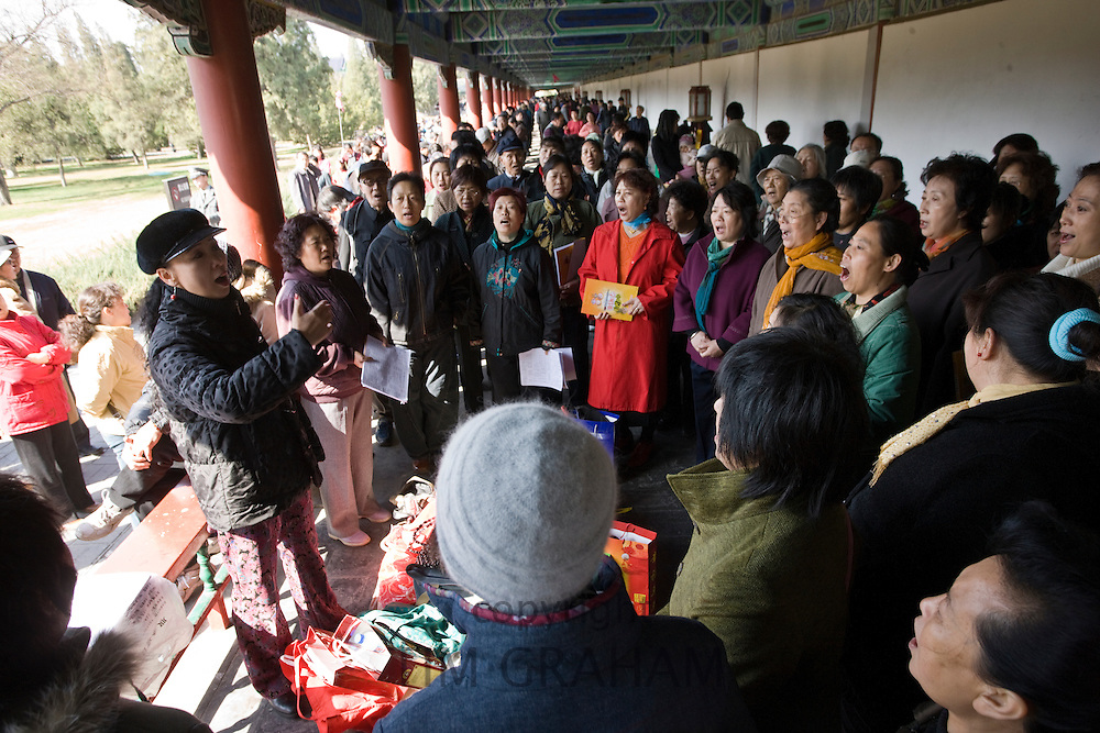 Singing group in the Ghost Corridor at park of the Temple of Heaven, Beijing, China