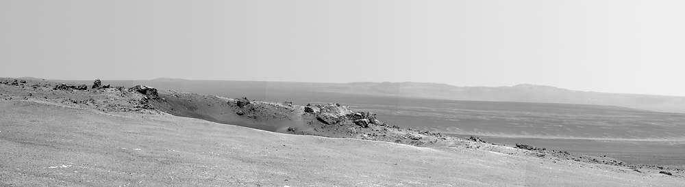 NASA's Mars Exploration Rover Opportunity arrived at the rim of Endeavour crater on Aug. 9, 2011, after a trek of more than 13 miles lasting nearly three years since departing the rover's previous major destination, Victoria crater, in August 2008.