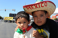 """Eduardo Salazar, 7, and his brother Josue, 2, at Sunday's """"El Grito,"""" or """"The Cry of Independence"""" celebrations in Salinas."""