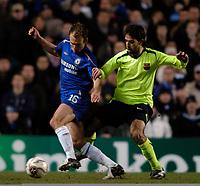 Photo: Richard Lane.<br />Chelsea v Barcelona. UEFA Champions League. 22/02/2006.<br />Chelsea's Arjen Robben (L) keeps the ball away from Oleguer.