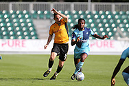 Matty Dolan of Newport county (l) holds off Marcus Bean of Wycombe wanderers. EFL Skybet football league two match, Newport county v Wycombe Wanderers at Rodney Parade in Newport, South Wales on Saturday 9th September 2017.<br /> pic by Andrew Orchard, Andrew Orchard sports photography.