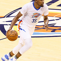 06 May 2016: Oklahoma City Thunder forward Kevin Durant (35) dribbles during the San Antonio Spurs 100-96 victory over the Oklahoma City Thunder, during Game Three of the Western Conference Semifinals of the NBA Playoffs at the Chesapeake Energy Arena, Oklahoma City, Oklahoma, USA.