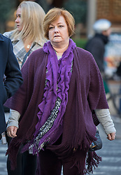 © Licensed to London News Pictures. 18/01/2017. London, UK. Suzy Evans, mother of terror attack survivor Owen Richards (not pictured) arriving at The Royal Courts of Justice for the third day of an inquest into the death of 30 Brits in the Tunisia terror attack. The attack took place is Sousse, Tunisia, when Seifeddine Rezgui killed 38 tourists on a beach outside Imperial Marhaba hotel. Photo credit : Tom Nicholson/LNP