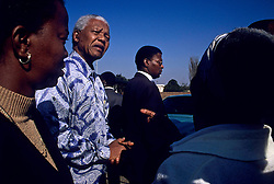 1994 - Kliptown, Soweto, South Africa - NELSON MANDELA greets people during a visit to a woman who used to hide him when he was on the run..(Credit Image: © Greg Marinovich/ZUMA Wire/ZUMAPRESS.com)