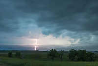 This supercell dropped hail the size of baseballs and brought a good lightning show as it got closer.