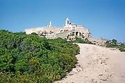 Chapelle de Notre Dame de la Serra, historic christian chapel on hillside above Calvi, Corsica, France in late 1950s