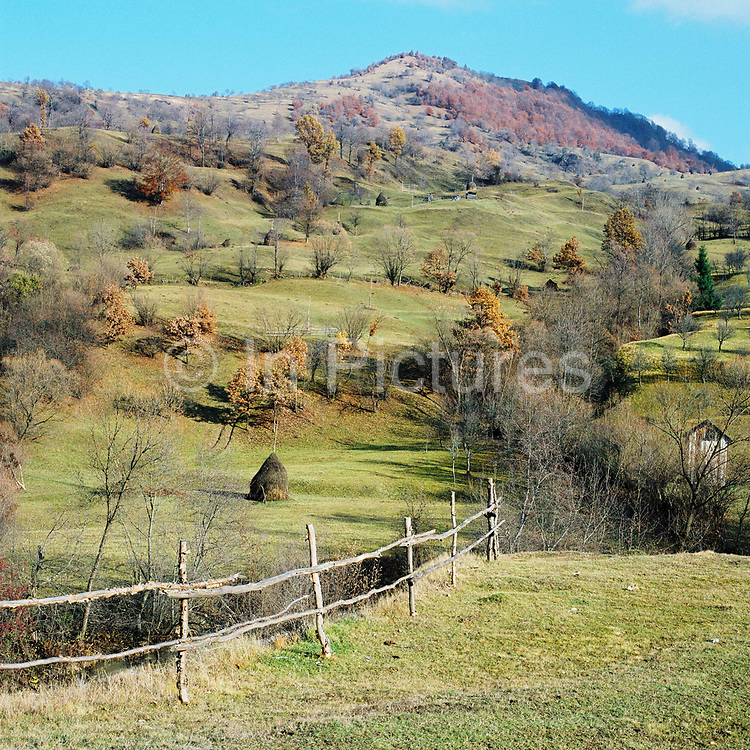 The agricultural landscape around the village of Botiza, Maramures, Romania. In the Romanian Carpathians, the agricultural landscape consists of a diverse mixture of small fields, meadows and orchards situated around villages, interspersed with forest and woodlands.