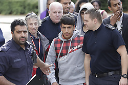 © Licensed to London News Pictures. 17/10/2016. Croydon, UK. A coach carrying displaced children from the Calais jungle refugee camp arrives at the Home Office immigration centre in Croydon. British authorities are bringing over about 100 children this week to be reunited with their relatives. The French government have announced that they will be dismantling the camp this month. credit: Peter Macdiarmid/LNP