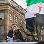 Dr Tamadur Abdullah speaking at an anti-Assad Syrian demonstration held in Whitehall, Central London. The demonstration was called by the Syrian Community in the UK under the head lines; Syrians are being killed in a genocide and the world is watching. Several hundreds gathered opposite Downing Street 10 calling for Syrians to unite and the world to intervene.