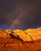 Departing storm with rainbow over the Echo Cliffs near Cedar Ridge, Navajo Reservation, Arizona.