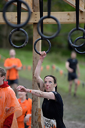 © Licensed to London News Pictures. 27/04/2014. Henley-on-Thames, UK Competitors take part in a Tough Mudder contest near Henley-on-Thames on 27th April 2014. Photo credit : Mike King/LNP