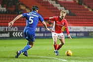 Charlton Athletic midfielder Ben Reeves (12) and AFC Wimbledon defender Will Nightingale (5) during the EFL Sky Bet League 1 match between Charlton Athletic and AFC Wimbledon at The Valley, London, England on 15 December 2018.
