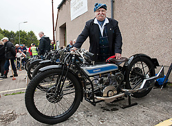 """© Licensed to London News Pictures. 24/05/2015. Warmley, South Gloucestershire UK.  Picture of Bill Douglas, great grandson of the founders of Douglas Motorcycles at the annual rally of vintage Douglas Motorcycles at Kingswood Heritage Museum.  The world famous Douglas bikes were built in Kingswood from 1907 to 1957. Some 25000 were constructed for military use in the First World War. The bikes were regular winners of the Isle of Man TT races. Bill Douglas, great grandson of the founders of the firm, said: """"It is always a stirring sight to see the bikes in action, and we expect a big turnout around the area to watch the cavalcade"""". Photo credit : Simon Chapman/LNP"""