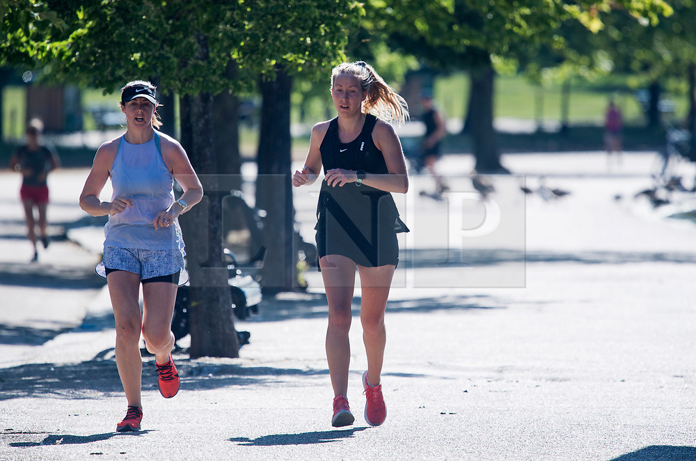 © Licensed to London News Pictures. 13/06/2021. London, UK. Joggers enjoy the warm weather in Hyde Park central London on a hot summer's day. Temperatures in the capital are expected to reach a high for the year. Photo credit: Ben Cawthra/LNP