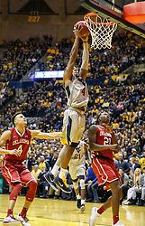 Jan 6, 2018; Morgantown, WV, USA; West Virginia Mountaineers guard Daxter Miles Jr. (4) dunks the ball during the second half against the Oklahoma Sooners at WVU Coliseum. Mandatory Credit: Ben Queen-USA TODAY Sports