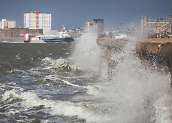 © Licensed to London News Pictures. 20/10/2017. Southsea, UK.  The Isle of Wight Hovercraft comes into Southsea as Rough seas crash against the sea wall near Southsea Common this morning, 20th October 2017. Southern England has been experiencing strong winds this morning, and is set for stronger winds as Storm Brian approaches from the Atlantic. Photo credit: Rob Arnold/LNP
