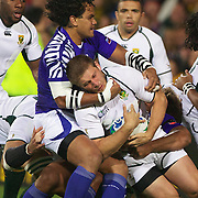 Maurie Fa'asavalu, Samoa, tackles Fourie Du Preez, South Africa during the South Africa V Samoa, Pool D match during the IRB Rugby World Cup tournament. North Harbour Stadium, Auckland, New Zealand, 30th September 2011. Photo Tim Clayton...