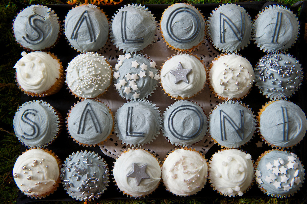 An array of branded cupcakes await guests at the Saloni autumn/spring 2010/2011 show held in the map room of the Royal Geographical Society, South Kensington, London on 20 September 2010.