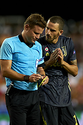 September 19, 2018 - Valencia, Spain - Leonardo Bonucci talk to the referee  Felix Brych during the Group H match of the UEFA Champions League between Valencia CF and Juventus at Mestalla Stadium on September 19, 2018 in Valencia, Spain. (Credit Image: © Jose Breton/NurPhoto/ZUMA Press)