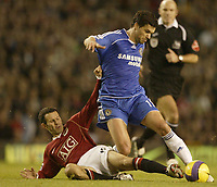 Photo: Aidan Ellis.<br /> Manchester United v Chelsea. The Barclays Premiership. 26/11/2006.<br /> Unnited's Ryan Giggs tackles Chelsea's Michael Ballack