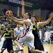 Efes Pilsen's Igor RAKOCEVIC (F), Ermal KURTOGLU (B) and Fenerbahce Ulker's Mirsad TURKCAN (R), Tarence Anthony KINSEY (L) during their Turkish Basketball league Play Off Final second leg match Efes Pilsen between Fenerbahce Ulker at the Ayhan Sahenk Arena in Istanbul Turkey on Saturday 22 May 2010. Photo by Aykut AKICI/TURKPIX