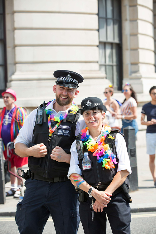 Carnival atmosphere for the Pride in London parade on the 7th July 2018 in central London in the United Kingdom. 30,000 marched through central London for the city's annual LGBT Pride celebration.
