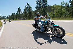 Dustin Hagins on the Annual Cycle Source and Michael Lichter Rides (combined this year) left from the new Broken Spoke area of the Iron Horse Saloon during the Sturgis Black Hills Motorcycle Rally. SD, USA.  Wednesday, August 10, 2016.  Photography ©2016 Michael Lichter.