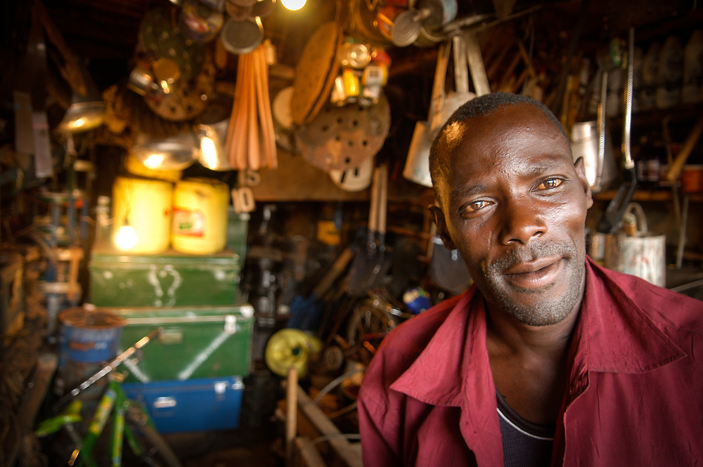 Peter Kiburu Masawe, chairman of Ushirika Usafe in Laini Sapa, in his hardware shop. Kibera in Nairobi is the biggest slum in Africa with around a million inhabitants. Potable water and waste management are not government supported and are resolved by community based organisations, CBOs. Maji Na Ufanisi an NGO focusing on water and sanitation works with Ushirika a CBO in the Soweto and Laini Sapa districts of the slum, supporting the construction of potable water infrastructure and community latrines, which are then managed by the community.