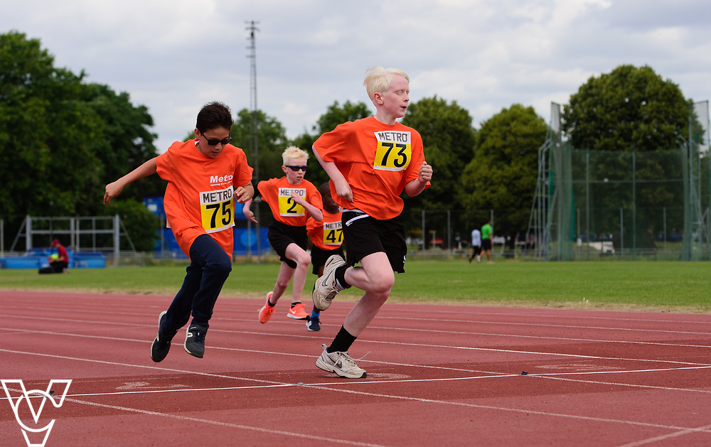 Event: 60 meters<br /> Competitors, from left: Competitor #75, Harry Hughes and Eoin Quigley<br /> <br /> Metro Blind Sport's 42nd Athletics Open, held at Mile End Stadium, Tower Hamlets, London.<br /> <br /> Picture: Chris Vaughan Photography for Metro Blind Sports<br /> Date: June 16, 2018