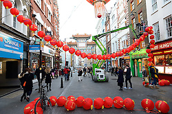 © Licensed to London News Pictures. 03/02/2016. London, UK. Workmen put up large red Chinese street lanterns in London's Chinatown in preparation of Chinese New Year celebration of Year of the Monkey. London's annual Chinese New Year celebrations are the biggest in the world outside China. Photo credit: Ray Tang/LNP