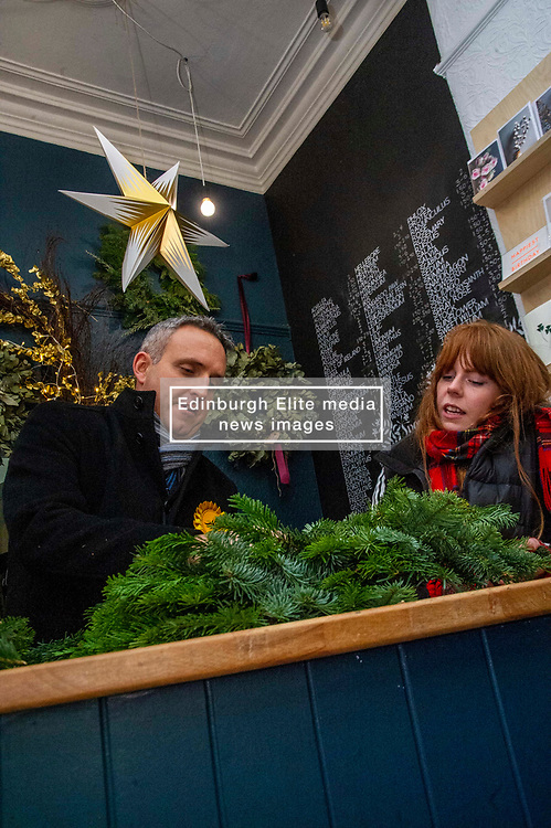 Pictured: Alex Cole-Hamilton<br /><br />Scottish Liberal Democrat Campaign Chair Alex Cole-Hamilton  was shwpon how to make Christmas wreaths by Elena Wilson while on the campaign trail at Rose & Ammi Florist in Edinburgh today.<br /><br />Ger Harley | EEm 10 December 2019