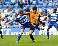 Photo. Chris Ratcliffe<br /> Reading v Wolverhampton Wanderers. Coca Cola Championship. 30/04/2005<br /> Ki-Hyeon Seol of Wolves takes the ball away from Steve Sidwell of Reading