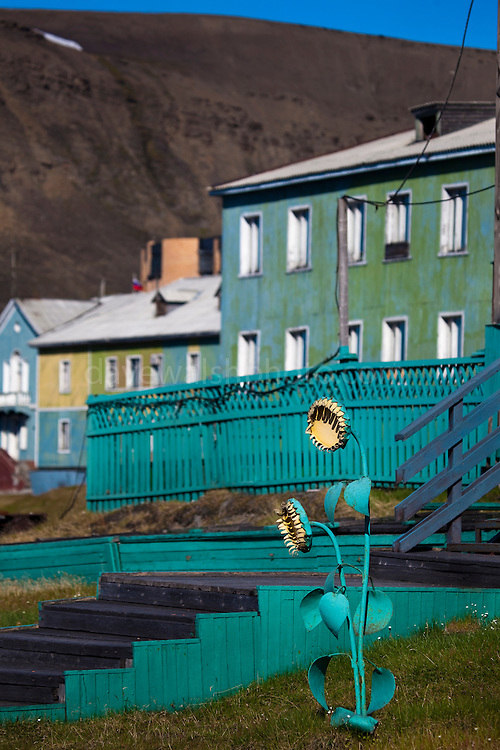 An artificial sunflower 'growsBarentsburg, a Russian coal mining town in the Norwegian Archipelego of Svalbard. Once home to about 2000 miners and their families, less than 500 people now live here.