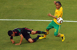 Mexico's Ricardo Osorio vs South Africa's Steven Pienaar during the Group A first round 2010 FIFA World Cup South Africa match between South Africa and Mexico at Soccer City Stadium on June 11, 2010 in Johannesburg, South Africa.  (Photo by Vid Ponikvar / Sportida)