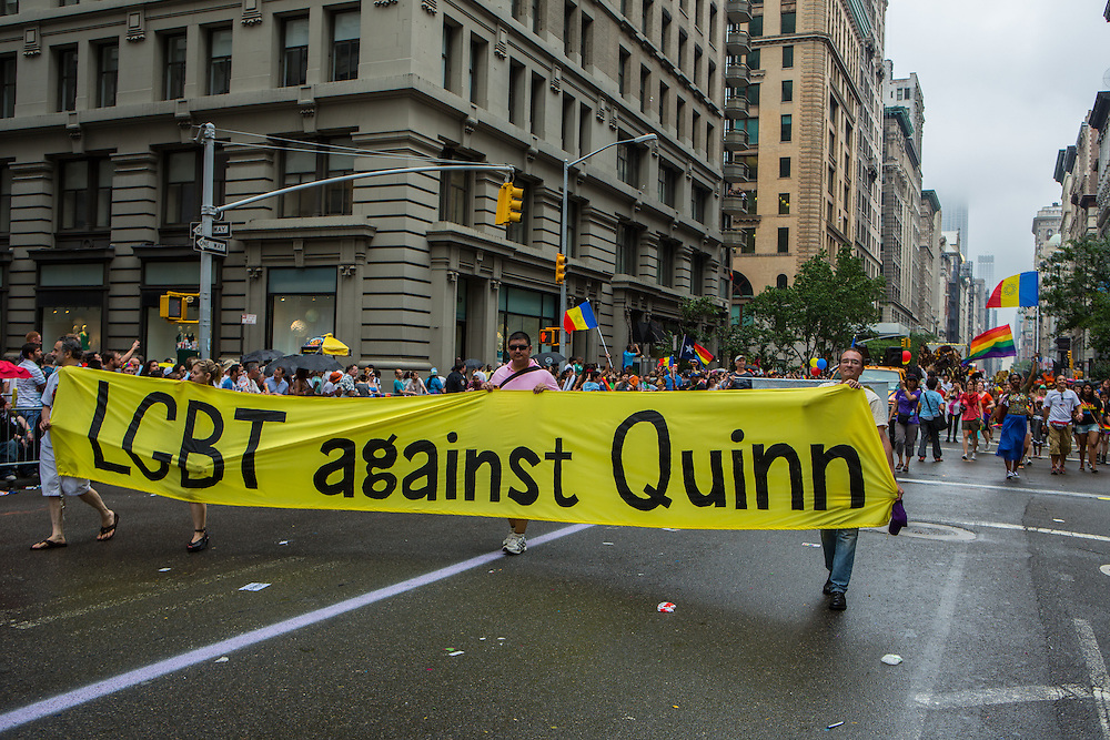 """Marchers carry a banner reading """"LGBT against Quinn."""" Christine Quinn, a lesbian City Councillor who is runing for mayor in 2013, has a number of detractors in the city."""