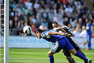Everton's Kevin Mirallas (11) heads past Swansea keeper Michel Vorm to score his sides 2nd goal.  Barclays Premier league, Swansea city v Everton at the Liberty stadium in Swansea, South Wales on Sat 22nd Sept 2012.   pic by  Andrew Orchard, Andrew Orchard sports photography,