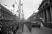 1916 Jubilee Commemorations- Parade and Ceremonies at the G.P.O. General view of the Military Parade at flag-decorated O'Connell Street. President Eamon de Valera (on reviewing stand) takes the salute as a Naval Detachment passes the G.P.O. On the reviewing stand also are the veterans of the 1916 Rising, with veterans of the War of Independence on the left facing the G.P.O..10.04.1966