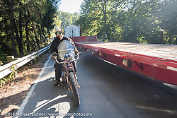 Clint Funderburg of Oregon on his 1916 Indian Motorcycle on a narrow bridge with as a semi with an oversized trailer navigates around him during the Cannonball Race of the Century. Stage-3 from Morgantown, WV to Chillicothe, OH. USA. Monday September 12, 2016. Photography ©2016 Michael Lichter.