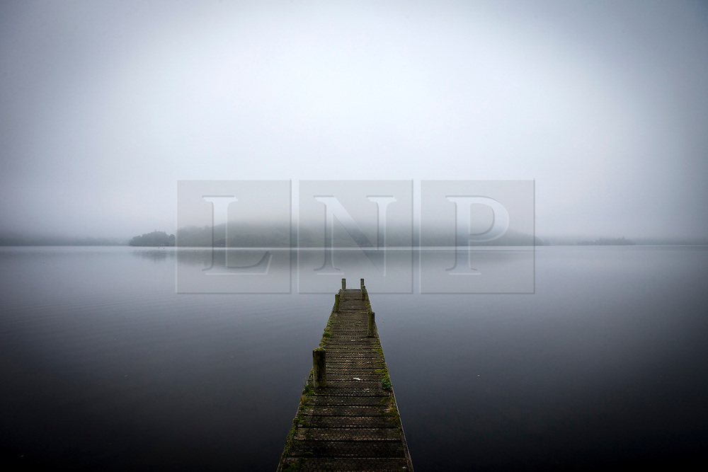 © Licensed to London News Pictures. 14/09/2016. Pooley Bridge UK. Picture shows a boat launch on the banks of Ullswater Lake in the morning mist near Pooley Bridge this morning. After last nights thunderstorms in the north of England Cumbria woke to a calm but misty morning. Photo credit: Andrew McCaren/LNP