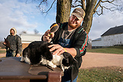 Kyle Wokatsch brushes one of the indoor family cats on his parents' farm in Marathon, WI, Monday November 11, 2019.
