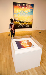 Pictured: Adeline Amar admires  Music from the Balconies (1984)<br /> Ed Ruscha exhibition. Titled, Music from the Balconies, it is the artist's first exhibition at the gallery for a decade<br /> <br /> <br /> Ger Harley | EEm 28 Aprl 2017