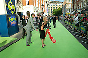 TRACIE BENNETT BEING HELPED WITH SCARF, SHREK press night arrivals. Theatre Royal. Drury Lane. London. 14 June 2011. <br /> <br />  , -DO NOT ARCHIVE-© Copyright Photograph by Dafydd Jones. 248 Clapham Rd. London SW9 0PZ. Tel 0207 820 0771. www.dafjones.com.