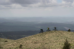 Mountain bikers riding bikes on mountain