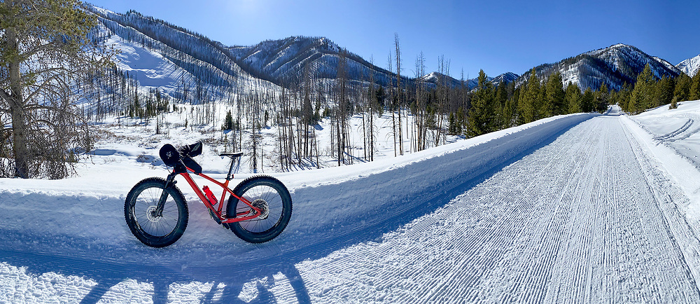 Perfectly groomed road up an Idaho Canyon is perfect for Snow Biking in Winter Time near Sun Valley.  Licensing and Open Edition Prints.