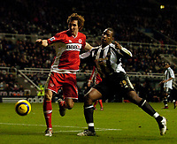 Photo: Jed Wee.<br />Newcastle United v Middlesbrough. The Barclays Premiership. 02/01/2006.<br />Middlesbrough's Emanuel Pogatetz (L) challenges Newcastle's Titus Bramble for possession.