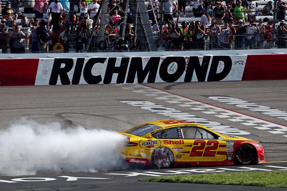Apr 30, 2017; Richmond, VA, USA; NASCAR Cup Series driver Joey Logano (22) celebrates winning the Toyota Owners 400 at Richmond International Raceway. Mandatory Credit: Peter Casey-USA TODAY Sports