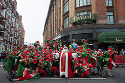 © Licensed to London News Pictures.02/11/2013. London, UK. Father Christmas waves to the crowds during the annual Harrods Christmas Parade on November 2 in Knightsbridge, London. Photo credit : Peter Kollanyi/LNP